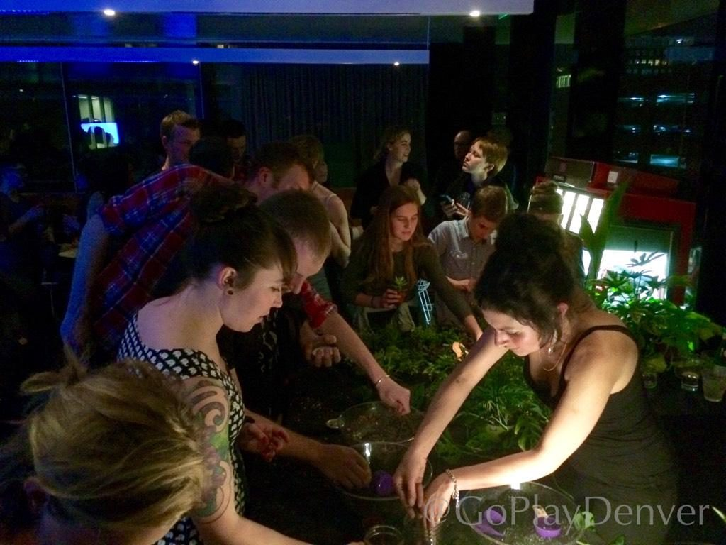 Guests create alien-themed terrariums during a Black Sheep Friday event at the MCA.