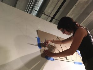Artist-in-residence, Sandra Fettingis at work creating a mural in her studio space at Redline.