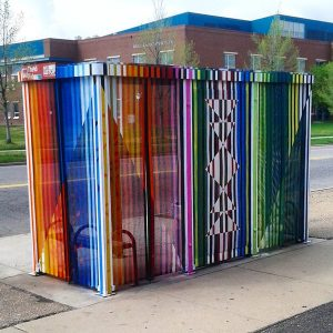 Bus shelter painted by Birdseed Collective. Image by @KobeAnDenver via Twitter