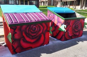 Dumpsters painted by Thomas as part of a P.S. You Are Here Grant project in Sunnyside.