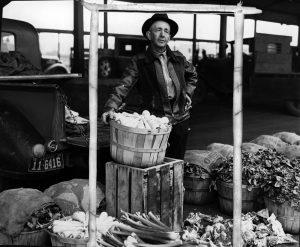 A produce vendor at Denargo Market circa 1939.
