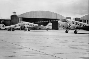 Planes belonging to Monarch Airlines near a hangar at Stapleton circa 1940. Image courtesy Stephen H. Hart Library & Research Center, History Colorado