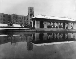 The former pavilion at the Sunken Gardens Park with West High School in the background. Image courtesy Stephen H. Hart Library & Research Center, History Colorado.