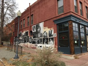 The exterior of Z Cuisine (temporarily closed) at 30th & Wyandot features a wheat paste photography gallery by artist Mark Sink. Image: Tara Bardeen