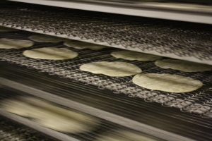 Fresh tortillas being made at Tortillas Mexico. Image courtesy Tortillas Mexico